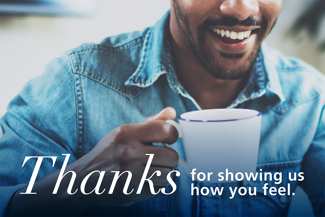 "Close up of man holding coffee mug with text below saying ""Thanks for showing us how you feel.""."