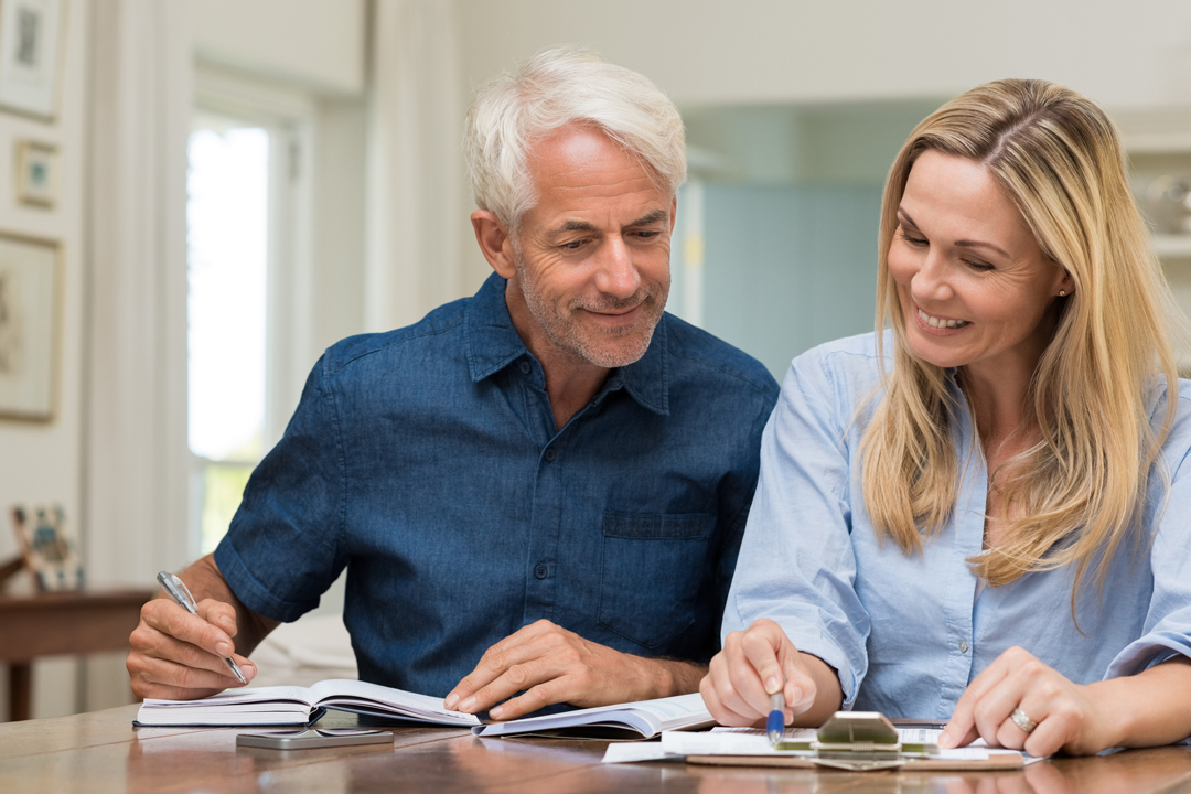 Older man and woman discussing finances