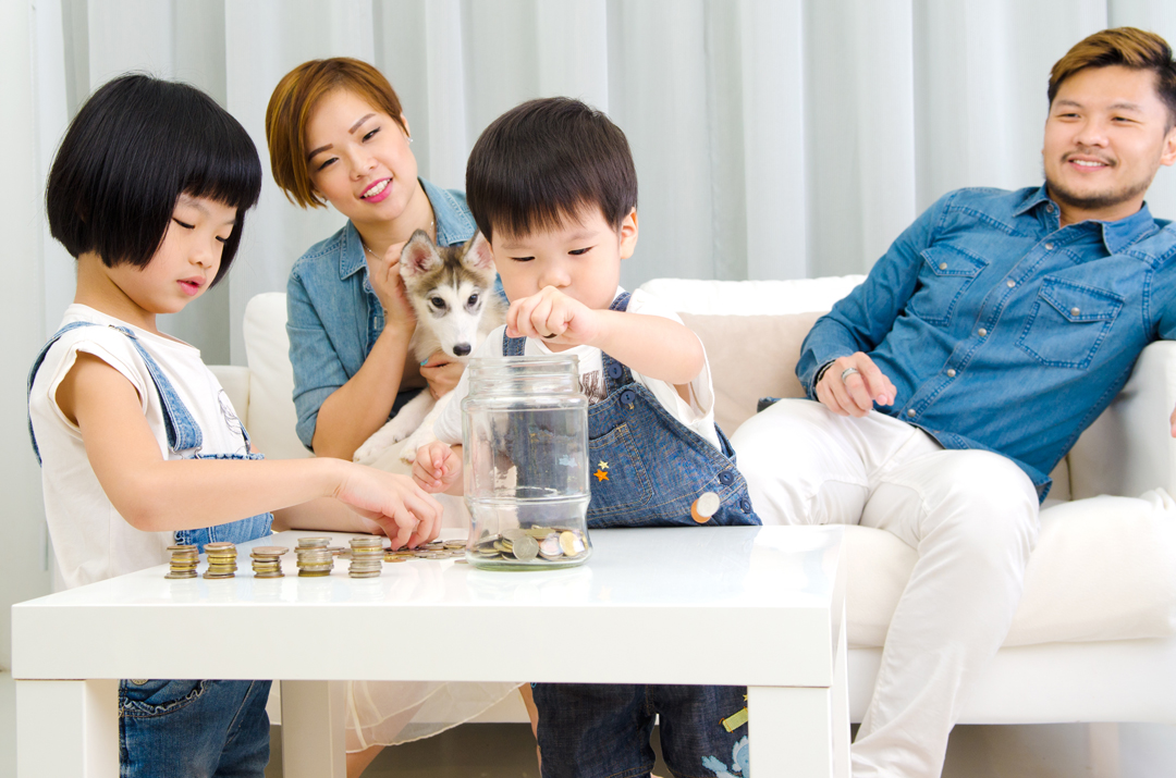 Asian family teaching about savings